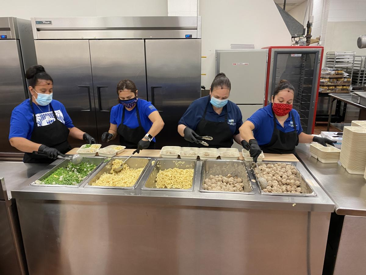 Meals on Wheels San Antonio Kitchen Crew Plating Meals